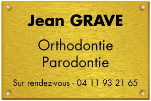 Exemple de plaque d'orthodontiste en laiton doré
